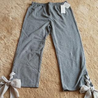 ナイガイ(NAIGAI)のマリアーニ裾リボンつき レギンス グレー(クロップドパンツ)