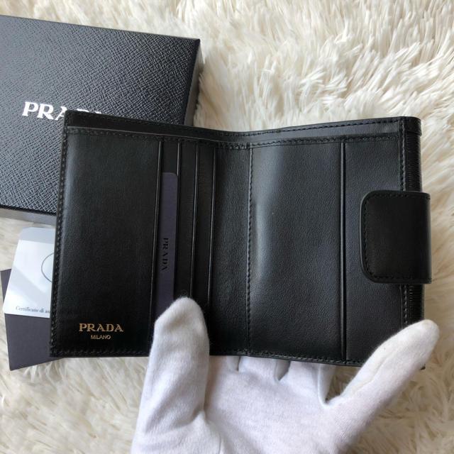 buy online 2ad77 d0297 新品 プラダ 縦サフィアーノ 折り財布 NERO ブラック リボン ♡