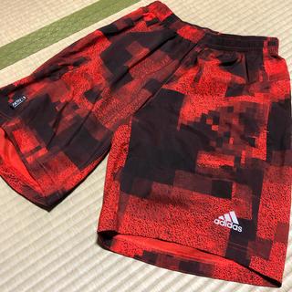 アディダス(adidas)のアディダス M エスノバ リフレクト デュアルショーツ オレンジ AX5889(ショートパンツ)