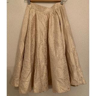 アッシュペーフランス(H.P.FRANCE)のyuumiaria 箔プリントスカート(ひざ丈スカート)
