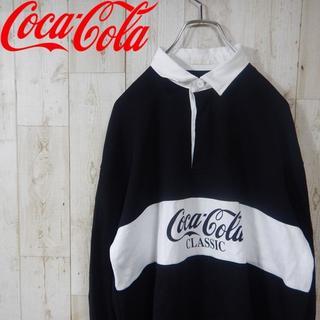 ジーユー(GU)のコカ・コーラ  90s ビッグロゴ 長袖ポロシャツ M ブラック(ポロシャツ)
