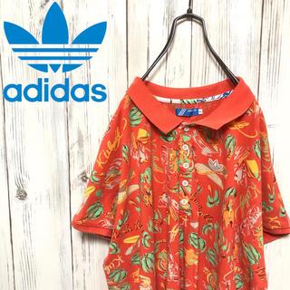 アディダス(adidas)の【希少】90s アディダスオリジナルス 総柄&ロゴワッペン付ポロシャツ(ポロシャツ)