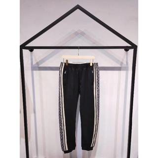 グッチ(Gucci)の【GUCCI】GGパターン柄 ジャージー パンツ 黒(スラックス)