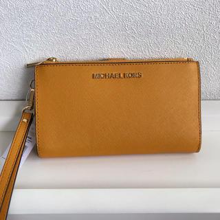 マイケルコース(Michael Kors)の新品未使用 マイケルコース クラッチバッグ 長財布 マルチケース マスタード(財布)