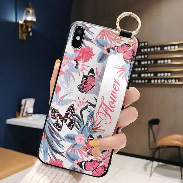 iPhone XR ハンドベルト付き チョウ柄 ptjの通販 by モッティ's shop|ラクマ