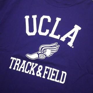 チャンピオン(Champion)のUCLA ウィングフッド プリントTシャツ パープル カリフォルニア カレッジT(Tシャツ/カットソー(半袖/袖なし))