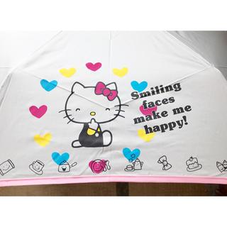 サンリオ(サンリオ)の【新品】Hello Kitty 手提げ袋付き折りたたみ傘(キャラクターグッズ)