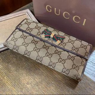 04792d0db8b8 グッチ(Gucci)のGUCCI リボンWホック長財布 GGキャンバス ブラウンベージュ(