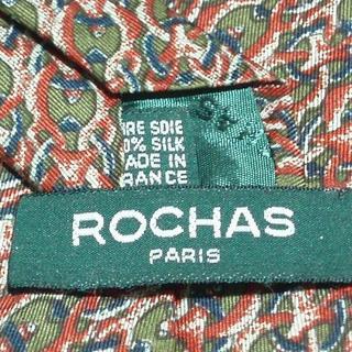 ロシャス(ROCHAS)の新品同様フランス製ロシャス ROCHASネクタイ(緑色赤色茶色系 幾何学柄(ネクタイ)