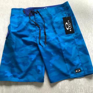 オークリー(Oakley)のOAKLEY オークリー ボードショーツ サーフパンツ W34 迷彩 青 未使用(水着)