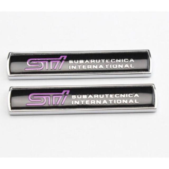 スバル(スバル)の【新品】SUBARU スバル STIロゴ 3Dエンブレムステッカー 色:ブラック 自動車/バイクの自動車(車外アクセサリ)の商品写真
