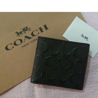 不動の1位‼️  コーチ二つ折り財布  ブラック  箱とショップ袋付き♪