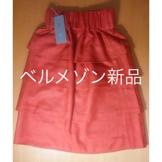 ベルメゾン(ベルメゾン)の☆新品タグ付き☆ ベルメゾン  4段フリルのフレアスカート オレンジ色 S〜M(ミニスカート)