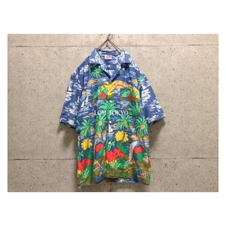 [used] blue comic design aloha shirt.