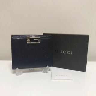 グッチ(Gucci)のグッチ レザー コンパクト財布 G金具 バックル 黒 レディース メンズ 美品(財布)