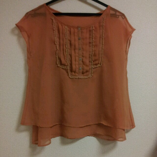 バーニーズニューヨーク(BARNEYS NEW YORK)のバーニーズのオレンジトップス(Tシャツ(半袖/袖なし))