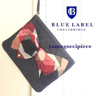 バーバリーブルーレーベル(BURBERRY BLUE LABEL)の赤チェックリボンモチーフ*クラッチバッグ*ブルーレーベルクレストブリッジ(クラッチバッグ)