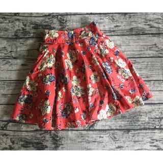 ティティアンドコー(titty&co)のtitty&Co オレンジの花柄のスカート S(ミニスカート)