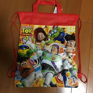 トイストーリー(トイ・ストーリー)の新品*ディズニー トイストーリー ナップサック 手提げバッグ 2way  赤(その他)