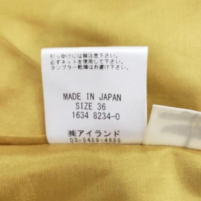 GRACE CONTINENTAL(グレースコンチネンタル)のグレースコンチネンタル イエロートップス フラワー ノースリーブ フリル 黄色 レディースのトップス(シャツ/ブラウス(半袖/袖なし))の商品写真