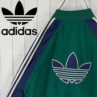 アディダス(adidas)のアディダス バックロゴ ゆるだぼ 90s ナイロン ジャージ ノーカラー 可愛い(ナイロンジャケット)