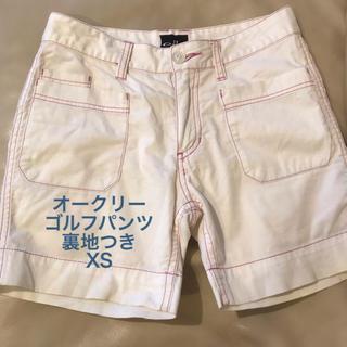 オークリー(Oakley)のOAKLEY ゴルフ レディース ショートパンツ XS 白 ピンク糸(ウエア)