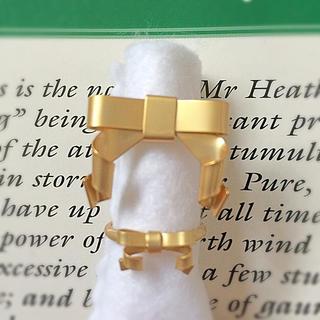 フェリシモ(FELISSIMO)のエリー様   おおたうに haco リボン ゴールド 指輪(リング(指輪))