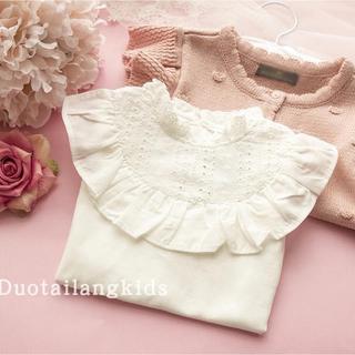 純白なフェミニンな刺繍地&フリルトップス