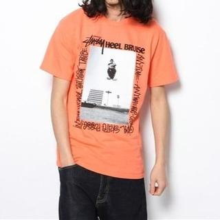 ステューシー(STUSSY)の【新品】ステューシー×ヒール ブルース オレンジ Tシャツ MB637(Tシャツ/カットソー(半袖/袖なし))