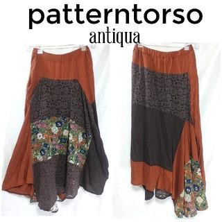 アンティカ(antiqua)のパターントルソー アンティカ 異素材 変形 ロングスカート M 茶色(ロングスカート)