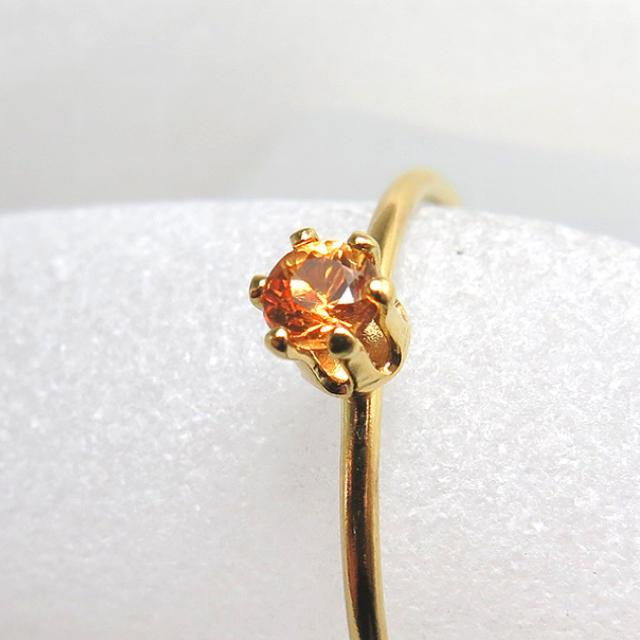 14kgf 天然石 オレンジサファイア リング レディースのアクセサリー(リング(指輪))の商品写真