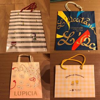 ロクシタン(L'OCCITANE)の紙袋4枚セット まとめ売り 宅配便 ゆうパック 宅配袋(ラッピング/包装)
