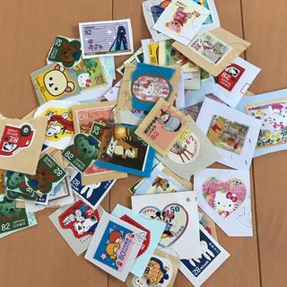 サンリオ(サンリオ)のキャラクター柄 使用済国内切手  台紙付き 約80枚(使用済み切手/官製はがき)