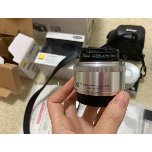 Nikon(ニコン)のJ5 Model1 NIKKOR double Lens kitめー222様専用 スマホ/家電/カメラのカメラ(その他)の商品写真