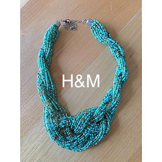 エイチアンドエム(H&M)のH&M購入 ボリューム ビーズ ネックレス エメラルドグリーン ゴールド(ネックレス)