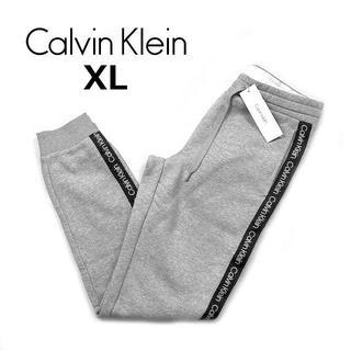 カルバンクライン(Calvin Klein)のカルバンクラインスウェット サイドラインジョガーパンツ(XL)グレー190108(その他)