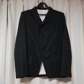 コモリ(COMOLI)のThe crooked Tailorウールヘリンボーンジャケット(テーラードジャケット)