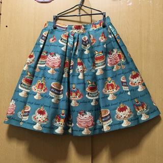 ジェーンマープル(JaneMarple)のJane Marple アニバーサリーケーキ柄 スカート グリーン(ひざ丈スカート)