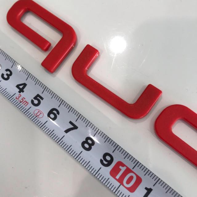 AUDI(アウディ)のアウディクワトロエンブレム 赤 新品 自動車/バイクの自動車(車外アクセサリ)の商品写真