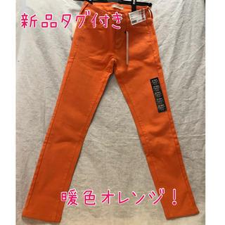 ユニクロ(UNIQLO)の【新品タグ付き】ウルトラストレッチカラージーンズ サイズ22 オレンジ ユニクロ(スキニーパンツ)