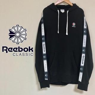 リーボック(Reebok)のReebok CLASSICS サイドテープロゴ プルオーバーバーカー(パーカー)