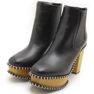 マウジー(moussy)のMOUSSYマウジーWOOD SOLE ブーツ柄BLK M(ブーツ)