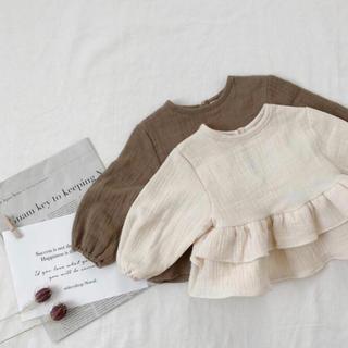 petit main - 韓国子供服 フリルトップス アイボリー