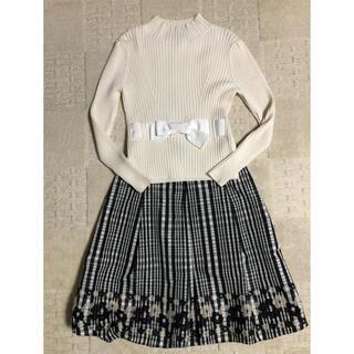 エムズグレイシー(M'S GRACY)のエムズグレーシー リボンセーター白と花柄バルーンスカートのセットアップ 美品(セット/コーデ)