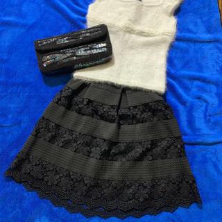ミーア(MIIA)のMIIA 花柄レーススカート黒(ひざ丈スカート)