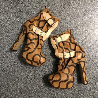 ヴィヴィアンウエストウッド(Vivienne Westwood)のスクイグル エレベーテッドボンテージブーツ(ブーツ)