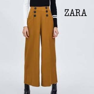 ザラ(ZARA)の【ZARA】フロントボタンつきワイドパンツ マスタード(カジュアルパンツ)