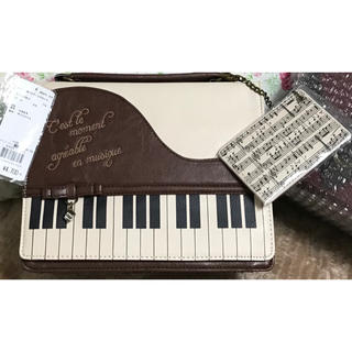 アクシーズファム(axes femme)のピアノバッグ(ハンドバッグ)