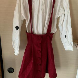ティティアンドコー(titty&co)の赤いスカート(ひざ丈スカート)