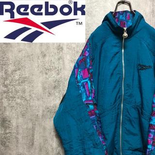 Reebok - 【激レア】リーボック☆ベクター刺繍ロゴ幾何学総柄切替マルチナイロンジャケット